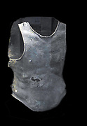 Bronze cuirass (breastplate) Greek or Italian, 4th century BC from Ruvo.  The muscled cuirass was popular from the 6th century BC onwards.  The sections were joined at the shoulders and sides, usually by straps and buckles in addition to hinges with removeable pins.