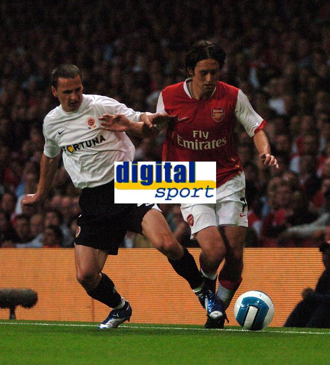 Photo: Tony Oudot.<br /> Arsenal v Sparta Prague. UEFA Champions League Qualifying. 29/08/2007.<br /> Tomas Rosicky of Arsenal goes past Martin Abraham of Sparta Prague