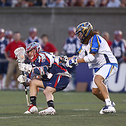 Kevin Buchanan #27 of the Boston Cannons keeps the ball from Josh Hawkins #3 of the Charlotte Hounds during the game at Harvard Stadium on May 17, 2014 in Boston, Massachuttes. (Photo by Elan Kawesch)