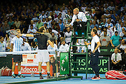 Andy Murray of Great Britain and Leon Smith, team captain of Great Britain debate a decision with the chair umpire during the Davis Cup Semi Final between Great Britain and Argentina at the Emirates Arena, Glasgow, United Kingdom on 16 September 2016. Photo by Craig Doyle.