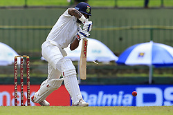 August 12, 2017 - Colombo, Sri Lanka - Indian cricketer Shikhar Dhawan  plays a shot as a part of his bat brakes  during the 1st Day's play in the 3rd Test match between Sri Lanka and India at the Pallekele International cricket stadium, Kandy, Sri Lanka on Saturday 12 August 2017. (Credit Image: © Tharaka Basnayaka/NurPhoto via ZUMA Press)