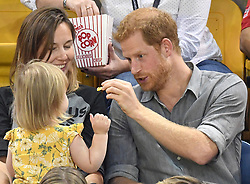 Michael Westwell from team Great Britain collects his Invictus Games seated volleyball silver medal with his 5 month old daughter Holly at the Mattamy Athletic Centre, Toronto, Ontario, Canada, on the 27th September 2017. 27 Sep 2017 Pictured: Prince Harry plays with Emily Henson, daughter of Invictus Games veteran Dave Henson, and feeds her popcorn as they watch the Invictus Games seated volleyball at the Mattamy Athletic Centre, Toronto, Ontario, Canada, on the 27th September 2017. Picture by James Whatling. Photo credit: James Whatling / MEGA TheMegaAgency.com +1 888 505 6342