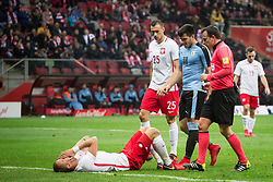 November 10, 2017 - Warsaw, Poland - Kamil Glik (lying), Jaroslaw Jach, Maximiliano Gomez and referee Istvan Vad during the international friendly soccer match between Poland and Uruguay at the PGE National Stadium in Warsaw, Poland on 10 November 2017  (Credit Image: © Mateusz Wlodarczyk/NurPhoto via ZUMA Press)