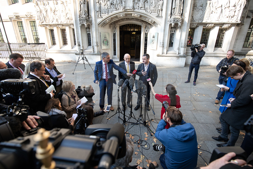 """© Licensed to London News Pictures. 10/10/2018. London, UK. Gareth Lee (right) speaks to media whilst leaving The Supreme Court after losing his case. Today the Supreme Court ruled that Daniel and Amy McArthur, owners of Ashers Bakery in Belfast, did not discriminate against Mr Lee by refusing to decorate a cake with the slogan """"Support Gay Marriage"""". The case has become known as the 'gay cake' case. Photo credit : Tom Nicholson/LNP"""