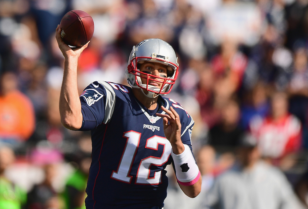 FOXBORO, MA - OCTOBER 16:  Tom Brady #12 of the New England Patriots throws during the first quarter of a game against the Cincinnati Bengals at Gillette Stadium on October 16, 2016 in Foxboro, Massachusetts.  (Photo by Billie Weiss/Getty Images)