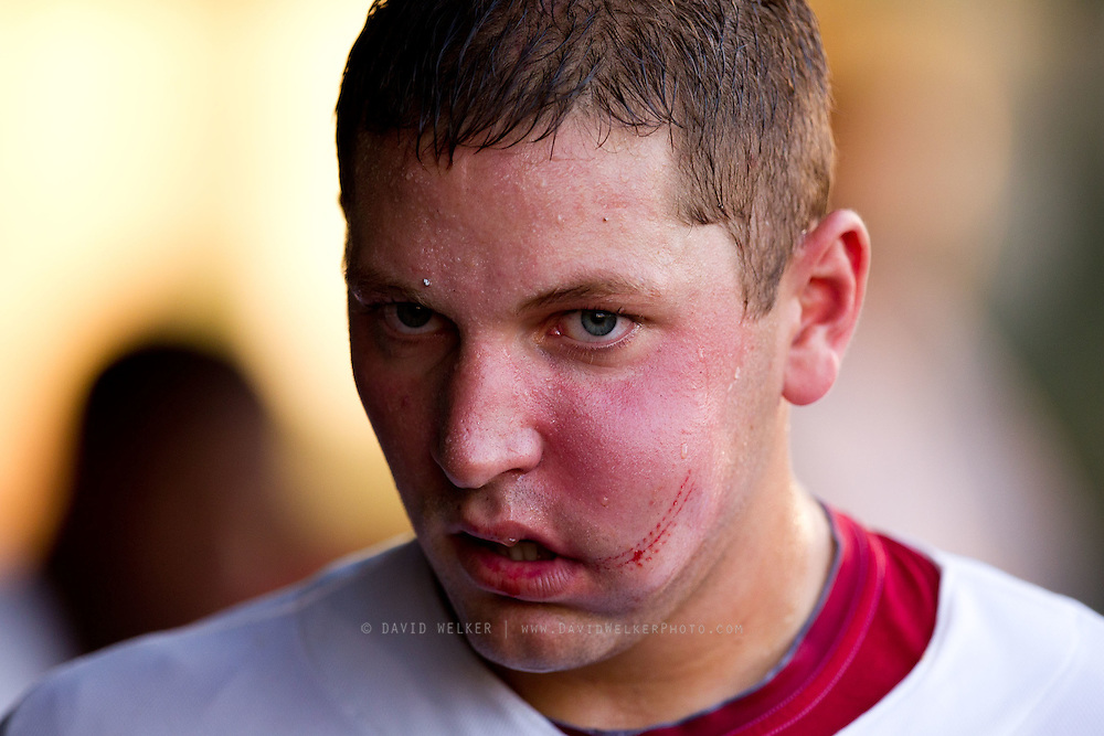 Travis Tartamella (29) of the Springfield Cardinals in the dugout after being hit in the face by a pitch during a game against the Arkansas Travelers at Hammons Field on July 25, 2012 in Springfield, Missouri. (David Welker/Four Seam Images)