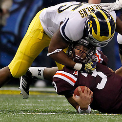 January 3, 2012; New Orleans, LA, USA; Michigan Wolverines linebacker Kenny Demens (25) tackles Virginia Tech Hokies quarterback Logan Thomas (3) during the first quarter of the Sugar Bowl at the Mercedes-Benz Superdome.  Mandatory Credit: Derick E. Hingle-USA TODAY SPORTS
