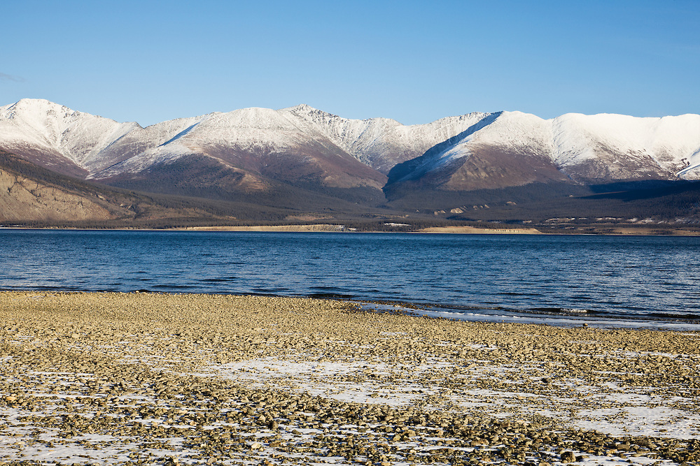 Kluane Lake, Ruby Range mountains and beach adjacent to Kluane National Park in Yukon Territory in Canada. Morning. Winter.