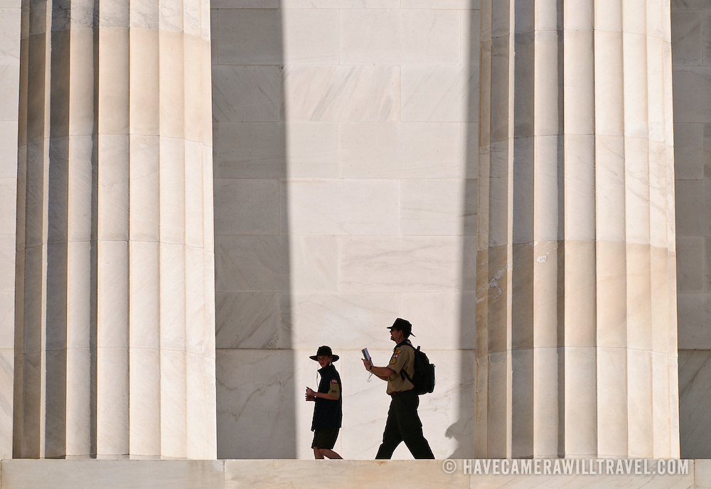 A scoutmaster and scout are dwarfed by the massive columns when they visit the Lincoln Memorial on the western end of the National Mall in Washington DC