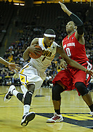 January 04 2010: Iowa Hawkeyes forward Melsahn Basabe (1) drives by Ohio State Buckeyes forward Jared Sullinger (0) during the first half of an NCAA college basketball game at Carver-Hawkeye Arena in Iowa City, Iowa on January 04, 2010. Ohio State defeated Iowa 73-68.