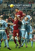 Photo: Ed Godden.<br />Coventry City v Brighton & Hove Albion. Coca Cola Championship. 04/02/2006. <br />Brighton players, Paul McShane and Colin Kazim-Richards leap for the ball.