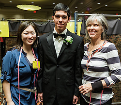 IRVINE, CA - MARCH 2:   Student Jeffrey Garcia poses after getting fitted with a tuxedo from Mens Wearhouse (www.menswearhouse.com) at the Working Wardrobes Dream Girls & Distinguished Gentlemen 2013 event at the Irvine Hilton in Irvine, CA. Working Wardrobes (http://www.workingwardrobes.org) is a non-profit organization located in Costa Mesa, CA. PHOTO: © 2013 SILVEX.PHOTOSHELTER.COM.