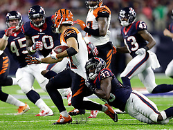Cincinnati Bengals' Alex Erickson (12) is tackled by Houston Texans running back Akeem Hunt (33) during the first half of an NFL football game Saturday, Dec. 24, 2016, in Houston. (AP Photo/Sam Craft)