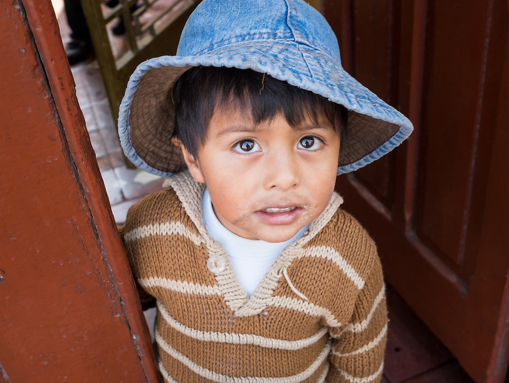 AREQUIPA, PERU - CIRCA APRIL 2014: Portrait of Peruvian kid in the streets of Arequipa. Arequipa is the Second city of Perú by population with 861,145 inhabitants and is the second most industrialized and commercial city of Peru.