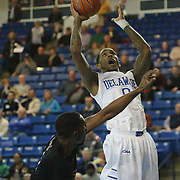 Delaware Guard Davon Usher (0) drives to the hoop as College of Charleston Forward Adjehi Baru (1) defends in the first half of a NCAA regular season Colonial Athletic Association conference game between Delaware and The College of Charleston Wednesday, Feb 5, 2014 at The Bob Carpenter Sports Convocation Center in Newark Delaware.