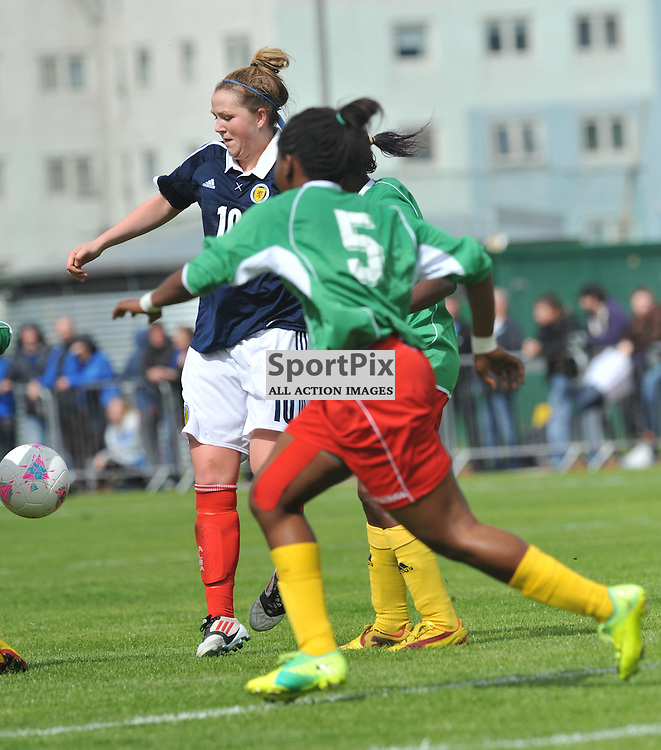 Augistine Sylvie Edjangue tries to stops Suzanne Lappin during the Cameroon vs Scotland in pre Olympic warm up match. 15th July 2012.