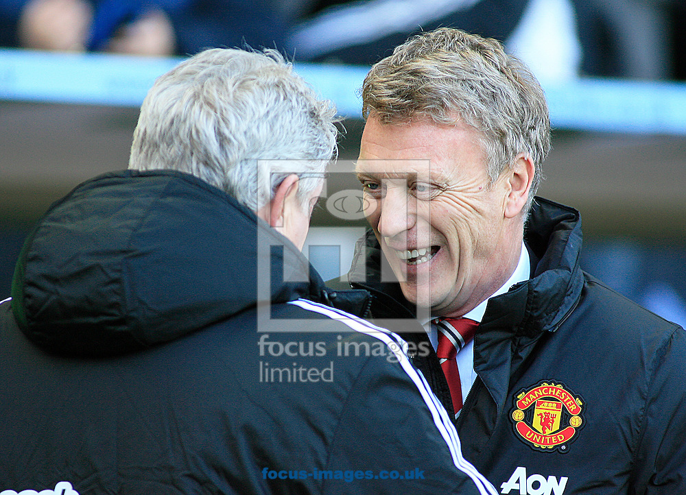 Picture by Richard Gould/Focus Images Ltd +44 7855 403186<br /> 26/12/2013<br /> Steve Bruce, manager (left) of Hull City David Moyes Manager of Manchester United during the Barclays Premier League match at the KC Stadium, Kingston upon Hull.