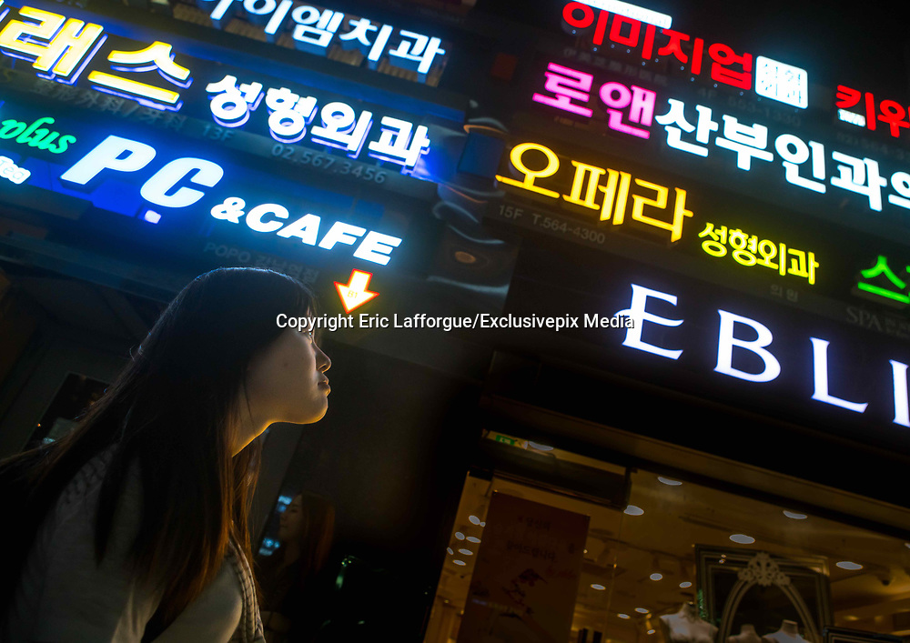 EXCLUSIVE<br /> A DEFECTOR'S LIFE IN SOUTH KOREA<br /> <br /> Kim is 16 years old and lives in Seoul, South Korea. She looks like any other teenager when you see her shopping in the street. But like 28,000 other refugees, she has escaped from North Korea.One morning in 2011, her mother could no longer bear the misery, lack of freedom and food deprivation, so she and her daughter escaped to seek refuge in the wealthy ultra-modern South Korea. Kim was 10 and had to leave the rest of her family, her friends and her school without even having the chance to say goodbye.<br /> They fled their country in secret by crossing on foot and by night the river making up the border with China. Their journey to reach South Korea took eight long months. After making it to China, her mother used her meager savings to pay smugglers to enter Laos, Thailand and finally South Korea. They arrived in the Land of Morning Calm in 2012.<br /> <br /> Photo shows: Her life in South Korea has been a time of discoveries and disappointments for Kim. She was amazed to see so many lights in the city. In North Korea, power was available only two hours a day at best. Kim still remembers vividly the poverty in North Korea. Everyday, she ate soup with rice – very rarely meat, a rich dish.<br /> ©Eric Lafforgue/Exclusivepix Media