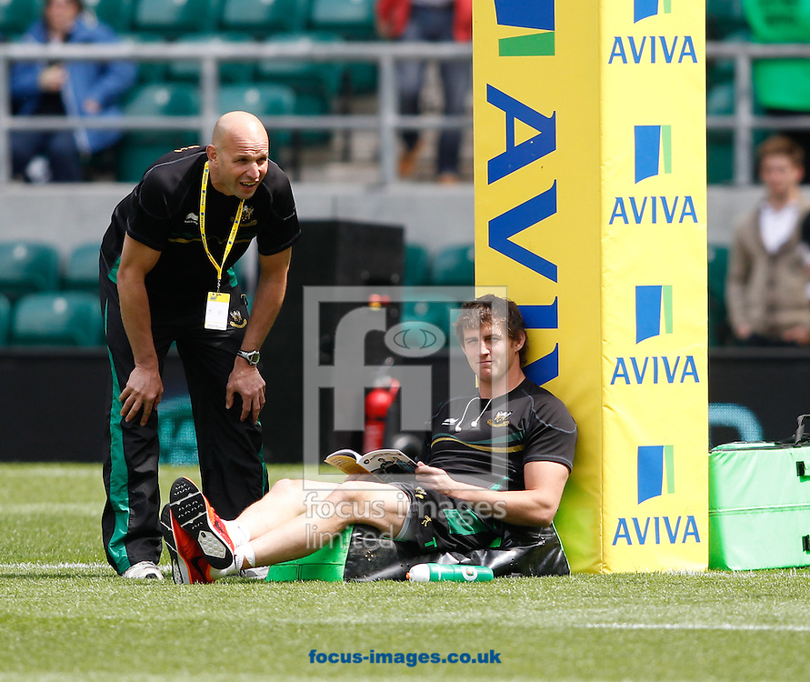 Picture by Andrew Tobin/Focus Images Ltd +44 7710 761829.25/05/2013. Northampton Director of Rugby Jim Mallinder (L) talks to Tom Wood who reads the match programme before the Aviva Premiership match at Twickenham Stadium, Twickenham.