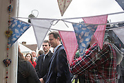 © Licensed to London News Pictures. 13/04/2015. Carshalton, UK. Nick Clegg (R) and Tom Brake outside The Corner Gallery.  Leader of the Liberal Democrats and Deputy Prime Minister Nick Clegg visits Carshalton and Wallington constituency on Monday (13th April) with Lib Dem candidate Tom Brake.  Photo credit : Stephen Simpson/LNP