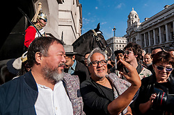 © Licensed to London News Pictures. 17/09/2015. London, UK. Internationally renowned artists, Ai Weiwei and Anish Kapoor, mark their solidarity for refugees in the current crisis by leading a walk from the Royal Academy of Arts in Piccadilly to Stratford, passing many of London's landmarks en route. Photo credit : Stephen Chung/LNP