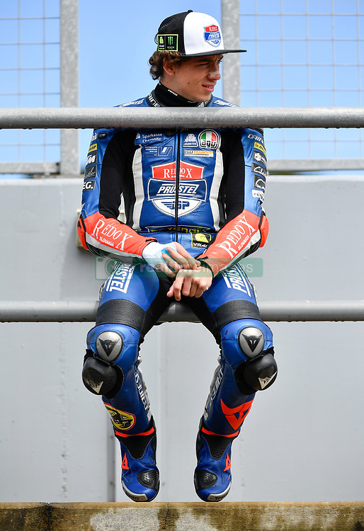 October 26, 2018 - Melbourne, Victoria, Australia - Italian rider Marco Bezzecchi (#12) of Redox PruestelGP waits on the pit wall during day 2 of the 2018 Australian MotoGP held at Phillip Island, Australia. (Credit Image: © Theo Karanikos/ZUMA Wire)