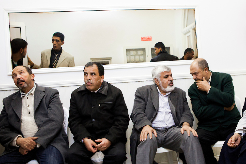Kairouan, Tunisia - 17 December, 2011: Said Ferjani (second from right), 57, senior member of the political and communication bureau of the Nahda (Renaissance) party, meets his lifetime friends of the Negra mosque in Kairouan, Tunisia on 17 December, 2011. In the 24 October 2011 Tunisian Constituent Assembly election, the first elections since the Tunisian Revolution, the party won 40% of the vote, and 89 of the 217 assembly seats, far more than any other party. Said Ferjani started his activism in the Negra mosque of his hometown Kairouan when he was 16 years old, debating on politics, philosophy, economy and world events. In 1989 former dictator Zine El Abidine Ben Ali turned against Nahda (or Ennahda) and jailed 25,000 activists. Said Ferjani was jailed and tortured. He then flew Tunisia and moved to the UK. He came back to Tunisia after 22 years, after former dictator Ben Ali flew the country.<br /> <br /> Gianni Cipriano for The New York Times