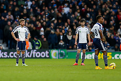 James Morrison, Claudio Yacob and Saido Berahino of West Brom looks dejected after Harry Kane of Tottenham Hotspur (not pictured) scores to make it 0-3 - Photo mandatory by-line: Rogan Thomson/JMP - 07966 386802 - 31/01/2015 - SPORT - FOOTBALL - West Bromwich, England - The Hawthorns - West Bromwich Albion v Tottenham Hotspur - Barclays Premier League.