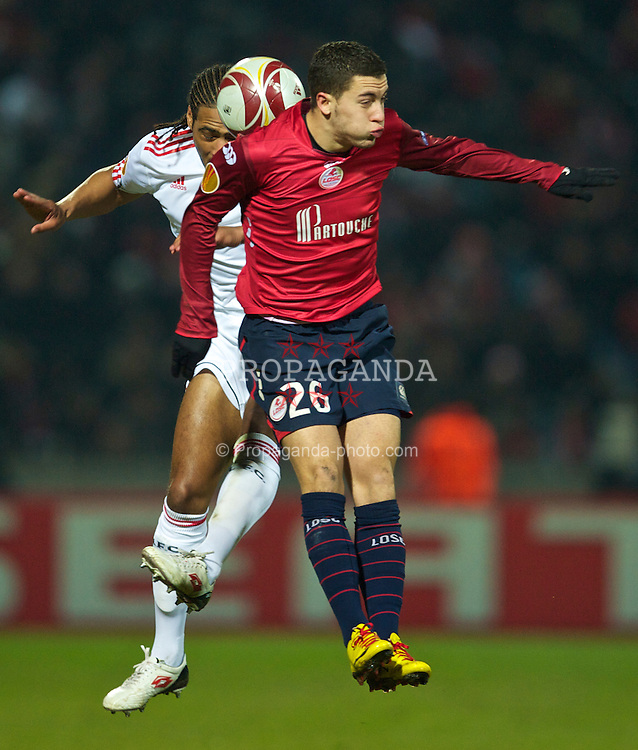 LILLE, FRANCE - Thursday, March 11, 2010: Liverpool's Glen Johnson and LOSC Lille Metropole's Eden Hazard during the UEFA Europa League Round of 16 1st Leg match at the Stadium Lille-Metropole. (Photo by David Rawcliffe/Propaganda)