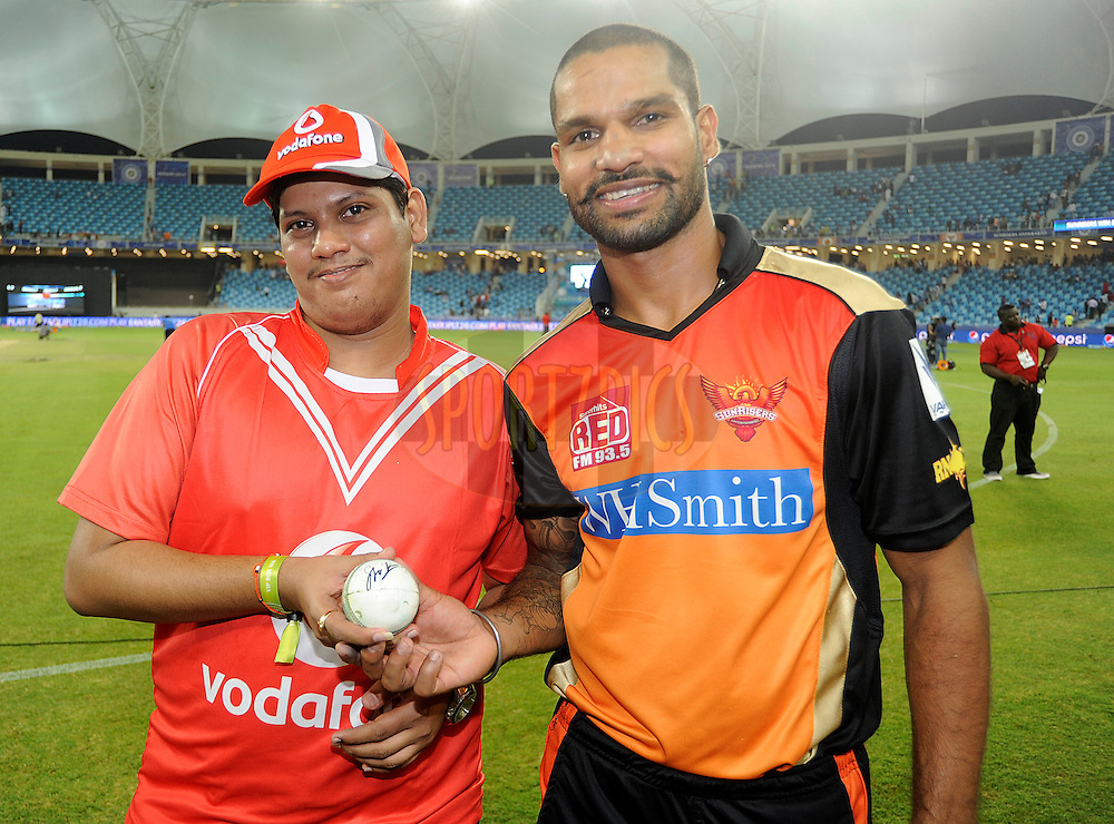 Shikhar Dhawan captain of the Sunrisers Hyderabad poses with the Vodafone winner during the presentation after match 20 of the Pepsi Indian Premier League Season 2014 between the Mumbai Indians and the Sunrisers Hyderabad held at the Dubai International Stadium, Dubai, United Arab Emirates on the 30th April 2014<br /> <br /> Photo by Pal Pillia / IPL / SPORTZPICS