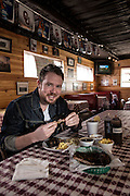 Jonathan Stranger, Chef at Ludivine Restaurant, eating at Railhead BBQ in Edmond for Oklahoma Today Magazine.