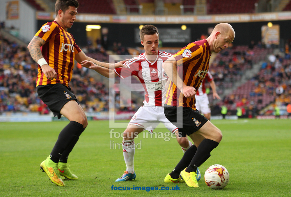 Jason Kennedy (R) of Bradford City on the attack against Jose Baxter (C) of Sheffield United during the Sky Bet League 1 match at the Coral Windows Stadium, Bradford<br /> Picture by Stephen Gaunt/Focus Images Ltd +447904 833202<br /> 18/10/2014
