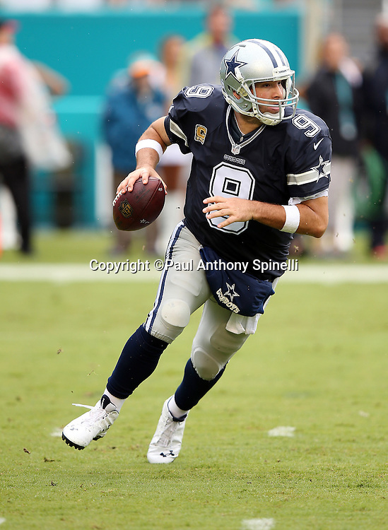 Dallas Cowboys quarterback Tony Romo (9) scrambles while looking to pass for a first down in the first quarter during the 2015 week 11 regular season NFL football game against the Miami Dolphins on Sunday, Nov. 22, 2015 in Miami Gardens, Fla. The Cowboys won the game 24-14. (©Paul Anthony Spinelli)