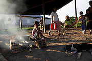 "A indio Ticuna family wait for the dinner..The people who live there call the tri-border area between Colombia, Brazil and Perù ""La Frontera"".  This area, in the past rich field for seringueiros (rubber gatherer) and most recently Pablo Escobars' base, don't keep trace of the wealth generated here but spended elsewhere. Amazon frontiers areas are notorious for their sparse population and limited state presence."
