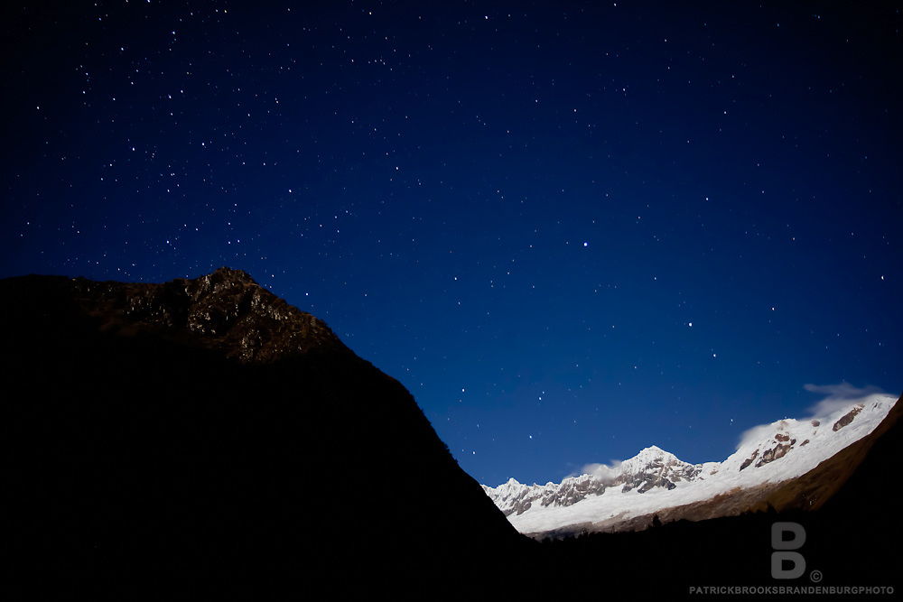 Stars and a slight moon exposure of snowy ridge between the peaks of Nevado Paron, or Paria in english (5600m), and Nevado Piramide (5885m) seen along The Santa Cuz Trek in the Cordillera Blanca of the Andes Mountains at Paria Camp. 8.14.11