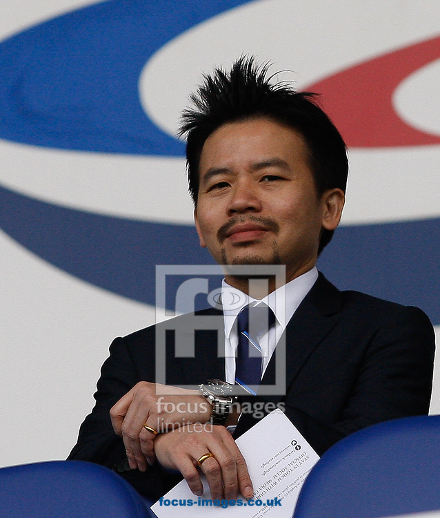 Samrit Bunditkitsada, a member of the Thai consortium looking to take ownership of Reading, looks on during the Sky Bet Championship match at the Madejski Stadium, Reading<br /> Picture by Andrew Tobin/Focus Images Ltd +44 7710 761829<br /> 16/08/2014