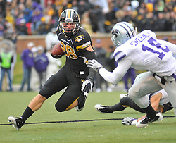 Nov 13, 2010; Columbia, MO, USA; Missouri Tigers wide receiver T.J. Moe (28) runs for yardage as Kansas State Wildcats cornerback Terrance Sweeney (16) attempts the tackle in the second half at Memorial Stadium. Missouri won 38-28. Mandatory Credit: Denny Medley-US PRESSWIRE