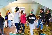 Student volunteers organize the storage space at The Gathering Place for the MLK day of service.