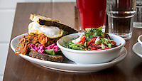 Dublin, Ireland - September 15, 2015: Slow-roasted pulled pork, with warm spices & fennel seed, served with a mustardy celeriac <br /> remoulade & beetroot & fresh baby spinach on griddled sourdough bread at Brother Hubbard, a new cafe in the emerging north side of Dublin. The cafe prides itself on serving food made in-house and will soon incorporate an edible garden in the courtyard. CREDIT: Chris Carmichael for the New York Times