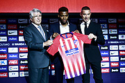 Atletico Madrid's new French midfielder Thomas Lemar (C) holds his jersey next to Atletico Madrid's President Enrique Cerezo (L) during his official presentation at the Wanda Metropolitano Stadium in Madrid on July 30, 2018. - Photo Benjamin Cremel / ProSportsImages / DPPI