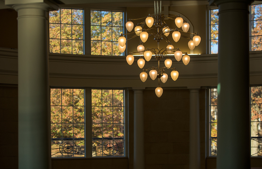 Autumn leaves are visible through windows above the entryway in Baker Center on November 12, 2016.