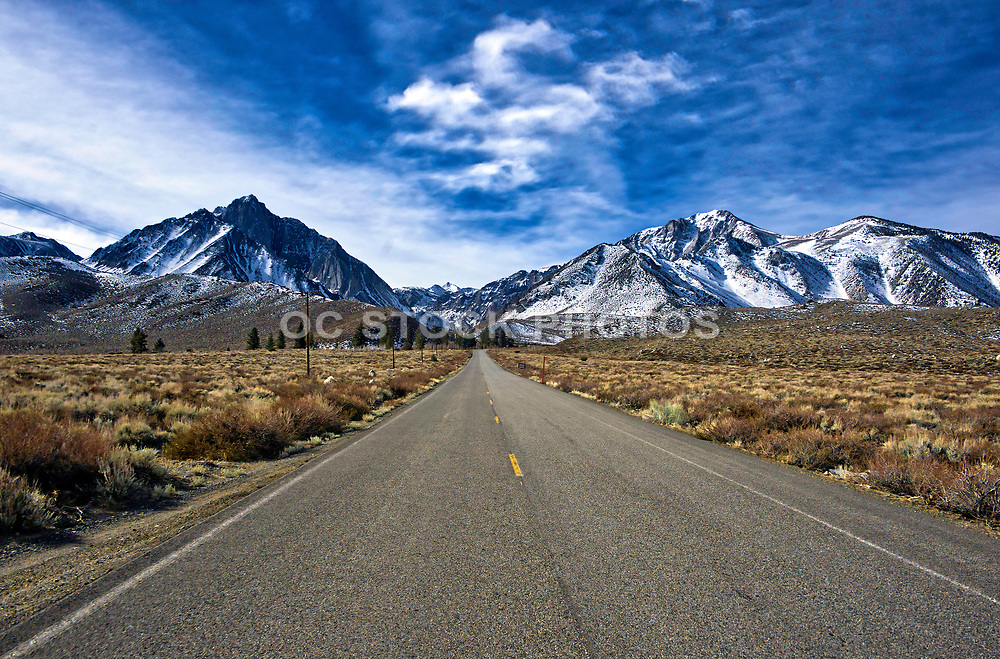 Driving Up On Convict Lake Road With Snow on the Mountains