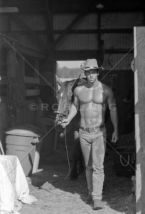 shirtless cowboy with his horse