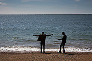Two unaccompanied minor refugee children stand on a beach in Kent. United Kingdom. (photo by Andrew Aitchison / In pictures via Getty Images)