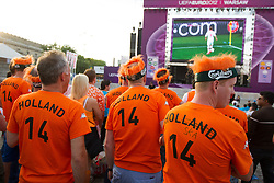 Supporters of Netherlands at Fan zone in the City centre during the UEFA EURO 2012 match between Netherlands and Denmark on June 9, 2012 in Fan zone Warsaw, Poland.  (Photo by Vid Ponikvar / Sportida.com)
