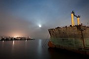 The ghost ships of Mothball Fleet: Incredible  pictures of abandoned Navy war ships taken by crew of illegal squatters<br /> <br /> They are the Navy ships that heroically fought in World War Two, now slowly rotting in a San Francisco bay.<br /> And as they are being towed, one by one, for scrapping, in just a few years they will all be gone.<br /> A group of illegal squatters gained unprecedented access to the vessels by rowing at night for two years past security and climbing onto the ships, sleeping secretly on board for days at a time.<br /> And as these stunning images show, their efforts were certainly worth it.<br /> The ships, which served the U.S. in four wars - World War Two, the Korean War, the Vietnam War and Desert Storm - are now stationed in Suisun Bay, 30 miles north east of San Francisco.<br /> The mothballed ships, which once numbered close to 400, have been out of action for a decade. 15 of the ships have already been scrapped and the whole fleet is expected to have disappeared by 2017.<br /> <br /> <br /> The squatting photographers, led by Scott Haefner, gained access to the ships over a two year period.<br /> They took months to prepare their voyages - analysing tidal patterns and security rotas - but despite many close calls managed to spend many days at a time on board.<br /> 'As news began to mount that the ships would finally be towed out for scrapping, we knew we had to act fast if we wanted to explore and document them,' Haefner said.<br /> <br /> <br /> 'We had fantasised for years about getting aboard and had to overcome numerous obstacles just to get to the ships. To get across the channel, we acquired a small, inflatable raft that was just big enough for the three of us and our gear, along with a small motor powered by a car battery.' <br /> The raft often had holes in and on one occasion they frantically had to keep pumping up the boat while still on water.<br /> 'On subsequent trips, we spent the entire weekend aboard the ships, each time on a different row. Because they are tethered closely together in rows, we had many ships to e