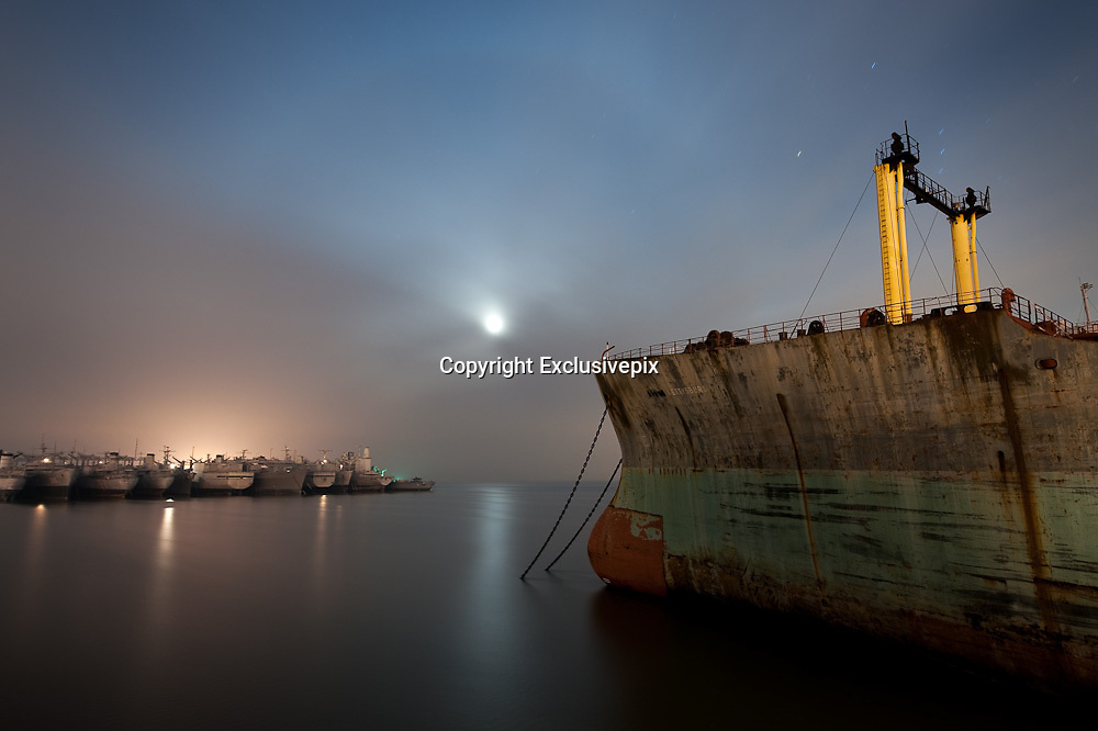 The ghost ships of Mothball Fleet: Incredible&nbsp; pictures of abandoned Navy war ships taken by crew of illegal squatters<br /> <br /> They are the Navy ships that heroically fought in World War Two, now slowly rotting in a San Francisco bay.<br /> And as they are being towed, one by one, for scrapping, in just a few years they will all be gone.<br /> A group of illegal squatters gained unprecedented access to the vessels by rowing at night for two years past security and climbing onto the ships, sleeping secretly on board for days at a time.<br /> And as these stunning images show, their efforts were certainly worth it.<br /> The ships, which served the U.S. in four wars - World War Two, the Korean War, the Vietnam War and Desert Storm - are now stationed in Suisun Bay, 30 miles north east of San Francisco.<br /> The mothballed ships, which once numbered close to 400, have been out of action for a decade. 15 of the ships have already been scrapped and the whole fleet is expected to have disappeared by 2017.<br /> <br /> <br /> The squatting photographers, led by Scott Haefner, gained access to the ships over a two year period.<br /> They took months to prepare their voyages - analysing tidal patterns and security rotas - but despite many close calls managed to spend many days at a time on board.<br /> 'As news began to mount that the ships would finally be towed out for scrapping, we knew we had to act fast if we wanted to explore and document them,' Haefner said.<br /> <br /> <br /> 'We had fantasised for years about getting aboard and had to overcome numerous obstacles just to get to the ships. To get across the channel, we acquired a small, inflatable raft that was just big enough for the three of us and our gear, along with a small motor powered by a car battery.' <br /> The raft often had holes in and on one occasion they frantically had to keep pumping up the boat while still on water.<br /> 'On subsequent trips, we spent the entire weekend aboard the ships, each time on a different row. Because they are tethered closely together in rows, we had many ships to e