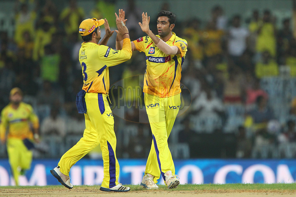 Ravichandran Ashwin and Suresh Raina celebrate the wicket of Unmukt Chand during match 64 of the Pepsi Indian Premier League between The Chennai Superkings and the Delhi Daredevils held at the MA Chidambaram Stadium in Chennai on the 14th May 2013..Photo by Ron Gaunt-IPL-SPORTZPICS   .. .Use of this image is subject to the terms and conditions as outlined by the BCCI. These terms can be found by following this link:..http://www.sportzpics.co.za/image/I0000SoRagM2cIEc