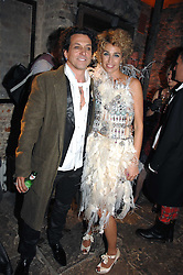 STEPHEN & ANASTASIA WEBSTER at the Stephen Webster launch party of his latest jewellery collection during the London Jewellery Week, at Wilton's Music Hall, Graces Alley, Off Ensign Street, London E1 on 12th June 2008.<br />