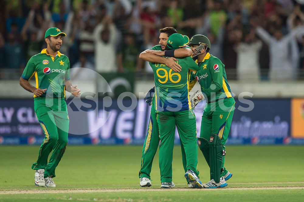 Pakistan celebrate the wicket of Alex Hales of England during the 2nd International T20 Series match between Pakistan and England at Dubai International Cricket Stadium, Dubai, UAE on 27 November 2015. Photo by Grant Winter.